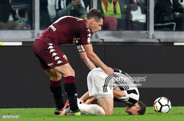 Andrea Belotti of Torino FC and Stephan Lichtsteiner of Juventus during the Serie A match between Juventus and Torino FC on September 23 2017 in...