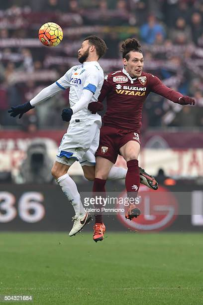 Andrea Belotti of Torino FC clashes with Andrea Costa of Empoli FC during the Serie A match between Torino FC and Empoli FC at Stadio Olimpico di...