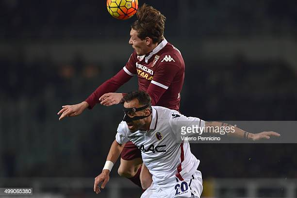Andrea Belotti of Torino FC clashes with DomenicoÊMaietta of Bologna FC during the Serie A match between Torino FC and Bologna FC at Stadio Olimpico...
