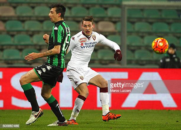 Andrea Belotti of Torino FC competes for the ball with Francesco Acerbi of US Sassuolo Calcio during the Serie A match betweeen US Sassuolo Calcio...