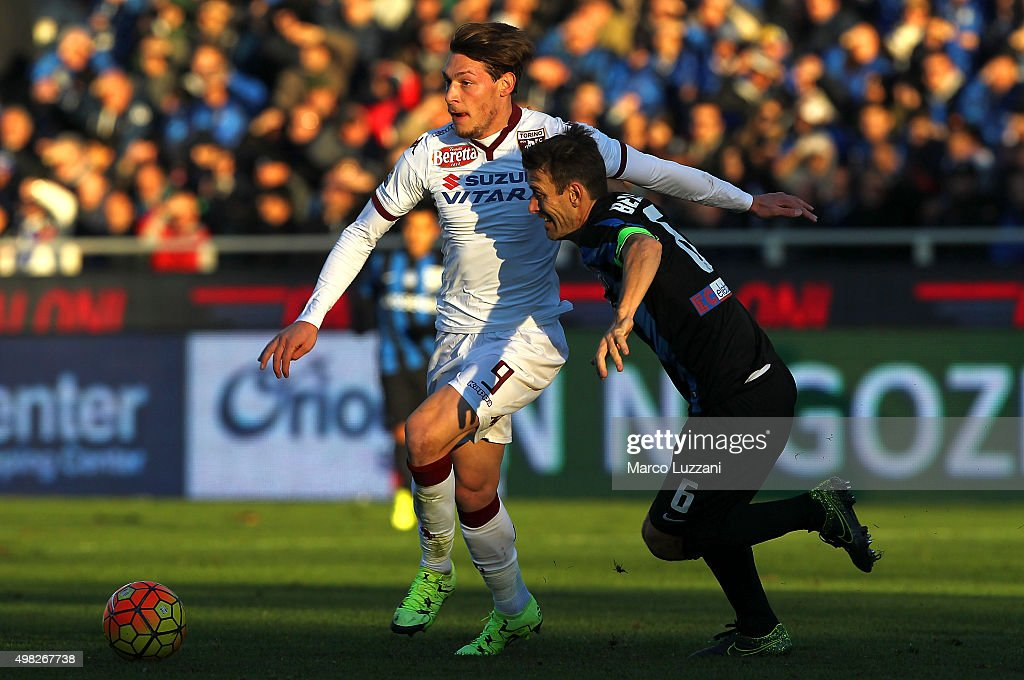Andrea Belotti of Torino FC competes for the ball with Gianpaolo Bellini of Atalanta BC during the Serie A match between Atalanta BC and Torino FC at Stadio Atleti Azzurri d'Italia on November 22, 2015 in Bergamo, Italy.