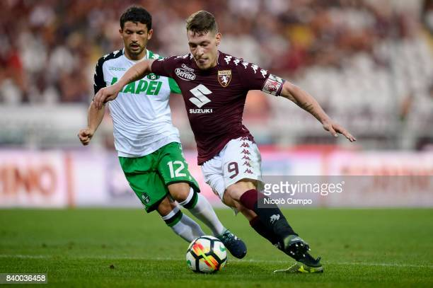 Andrea Belotti of Torino FC competes with Stefano Sensi of US Sassuolo during the Serie A football match between Torino FC and US Sassuolo Torino FC...