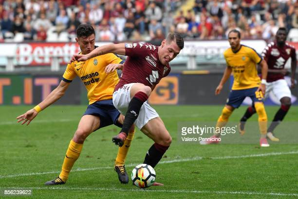 Andrea Belotti of Torino FC is challenged by Alex Ferrari of Hellas Verona FC during the Serie A match between Torino FC and Hellas Verona FC at...