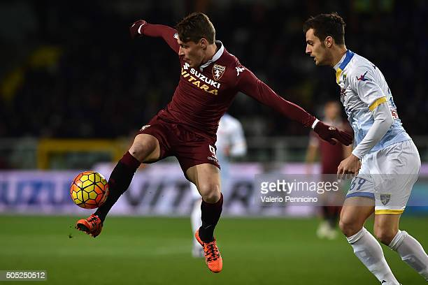 Andrea Belotti of Torino FC is challenged by Davide Bertoncinii of Frosinone Calcio during the Serie A match between Torino FC and Frosinone Calcio...