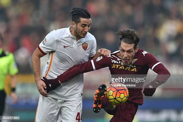 Andrea Belotti of Torino FC is challenged by Konstantinos Manolas of AS Roma during the Serie A match between Torino FC and AS Roma at Stadio...