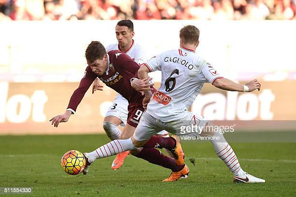 Andrea Belotti of Torino FC is challenged by Riccardo Gagliolo and Gaetano Letizia of Carpi FC during the Serie A between Torino FC and Carpi FC at...