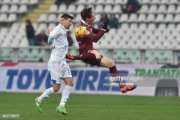 Andrea Belotti of Torino FC is tackled by Federico Barba of Empoli FC during the Serie A match between Torino FC and Empoli FC at Stadio Olimpico di...