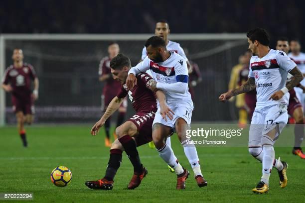 Andrea Belotti of Torino FC is tackled by Joao Pedro of Cagliari Calcio during the Serie A match between Torino FC and Cagliari Calcio at Stadio...