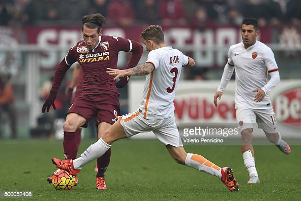Andrea Belotti of Torino FC is tackled by Lucas Digne of AS Roma during the Serie A match between Torino FC and AS Roma at Stadio Olimpico di Torino...