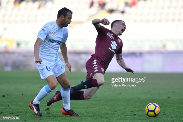 Andrea Belotti of Torino FC is tackled by Riccardo Meggiorini of AC Chievo Verona during the Serie A match between Torino FC and AC Chievo Verona at...