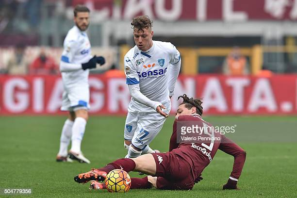 Andrea Belotti of Torino FC tackles Marcel Buchel of Empoli FC during the Serie A match between Torino FC and Empoli FC at Stadio Olimpico di Torino...