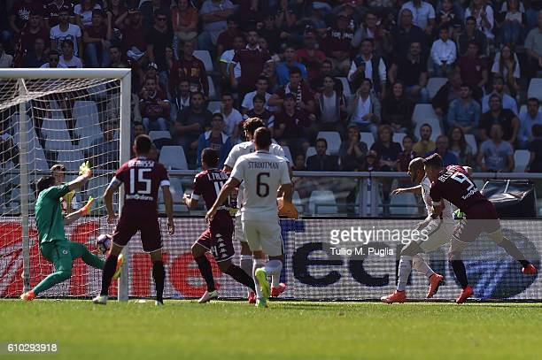 Andrea Belotti of Torino scores the opening goal during the Serie A match between FC Torino and AS Roma at Stadio Olimpico di Torino on September 25...