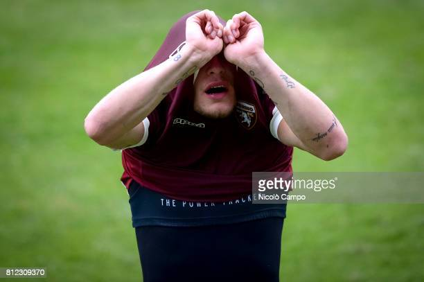 Andrea Belotti takes off his jersey at the end of a Torino FC training session