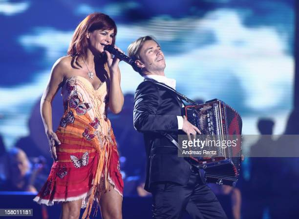 Andrea Berg and Florian Silbereisen perform on stage during the Andrea Berg 'Die 20 Jahre Show' at Baden Arena on December 7 2012 in Offenburg Germany