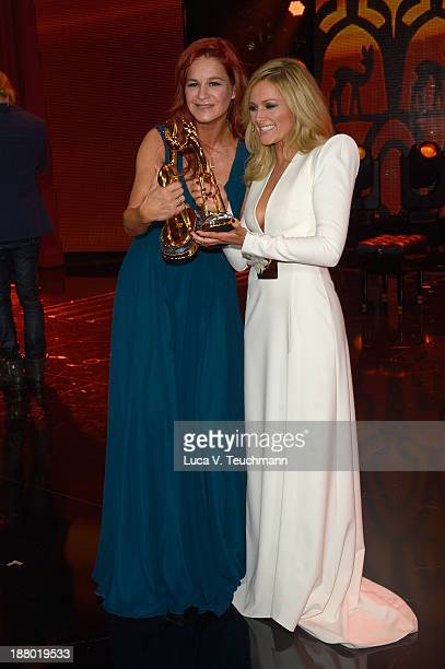 Andrea Berg and Helene Fischer talk on stage at the Bambi Awards 2013 at Stage Theater on November 14 2013 in Berlin Germany