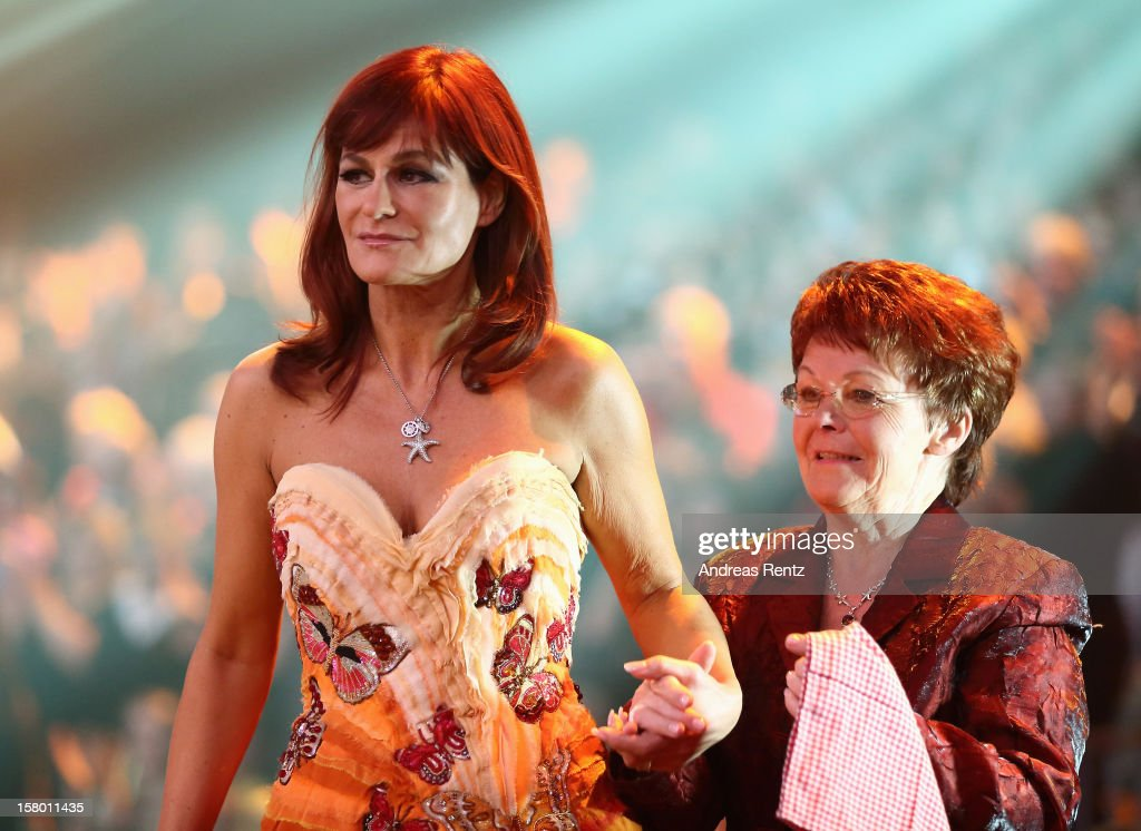 Andrea Berg and her mother Helga Zellen smile during the Andrea Berg 'Die 20 Jahre Show' at Baden Arena on December 7, 2012 in Offenburg, Germany.