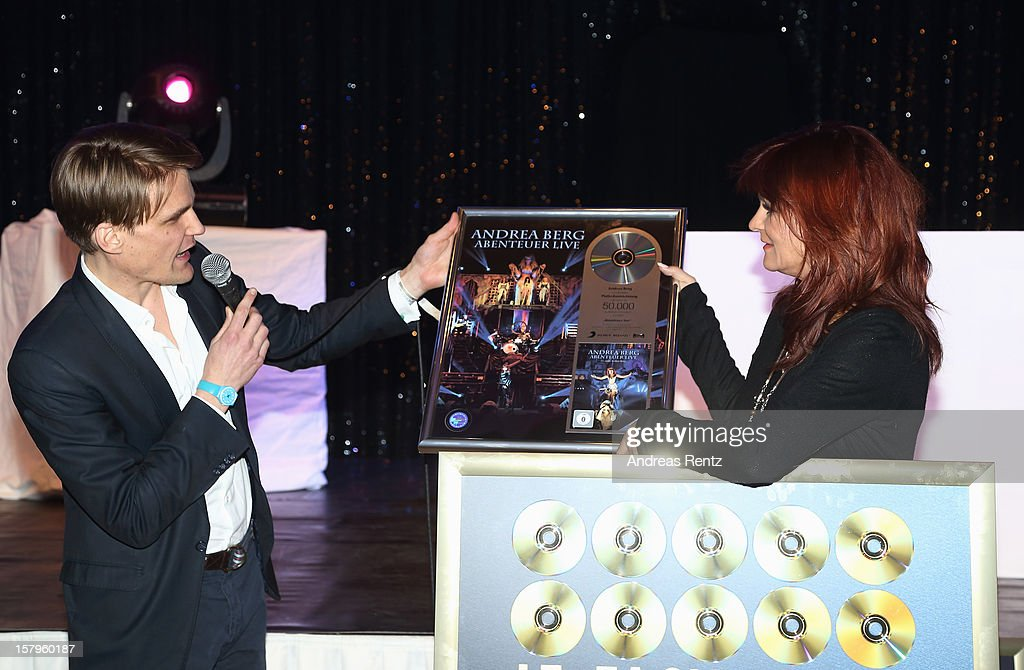 Andrea Berg receives a award, presented by Philip Ginthoer, Sony Music Entertainment Germany, during the after show party to the Andrea Berg 'Die 20 Jahre Show' on December 7, 2012 in Offenburg, Germany.