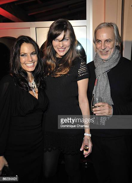 Andrea Bernholtz Mila Jovovich and guest attend the Rock Republic Paris Party at the 'tour eiffel'on october O3 2008 Paris France
