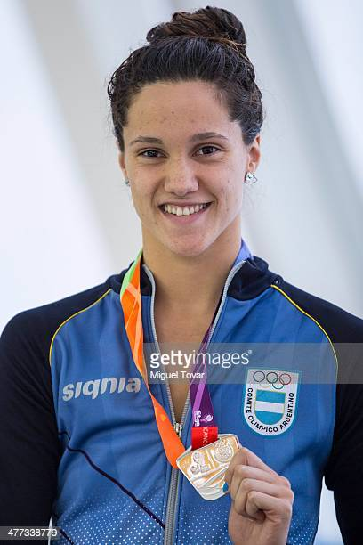 Andrea Berrino of Argentina shows her silver medal in 200m backstroke final event during day two of the X South American Games Santiago 2014 at...