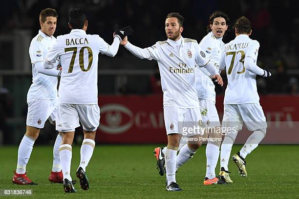 Andrea Bertolacci of AC Milan celebrates his goal with team mate Carlos Bacca during the Serie A match between FC Torino and AC Milan at Stadio...