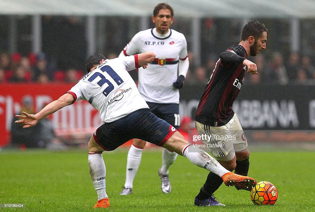 Andrea Bertolacci (R) of AC Milan competes for the ball with Blerim Dzemaili (L) of Genoa CFC during the Serie A match between AC Milan and Genoa CFC at Stadio Giuseppe Meazza on February 14, 2016 in Milan, Italy.