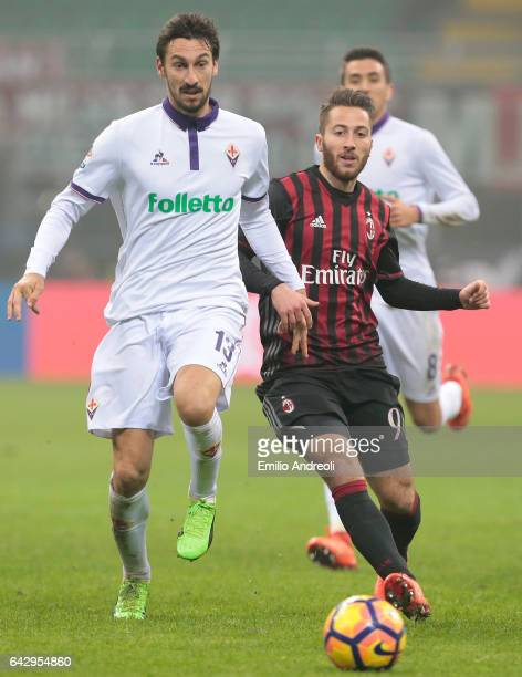 Andrea Bertolacci of AC Milan competes for the ball with Davide Astori of ACF Fiorentina during the Serie A match between AC Milan and ACF Fiorentina...