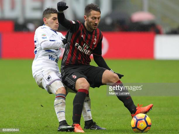 Andrea Bertolacci of AC Milan competes for the ball with Lucas Sebastian Torreira of UC Sampdoria during the Serie A match between AC Milan and UC...