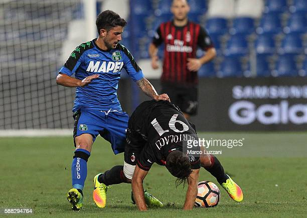 Andrea Bertolacci of AC Milan competes for the ball with Stefano Sensi of US Sassuolo during the TIM Preseason Tournament at Mapei Stadium Citta' del...