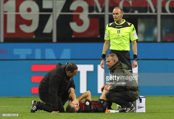 Andrea Bertolacci of AC Milan lies injured during the Serie A match between AC Milan and Genoa CFC at Stadio Giuseppe Meazza on March 18 2017 in...