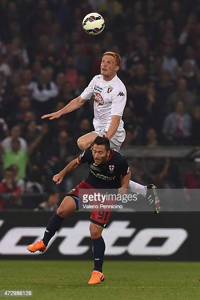 Andrea Bertolacci of Genoa CFC clashes with Alessandro Gazzi of Torino FC during the Serie A match between Genoa CFC and Torino FC at Stadio Luigi...
