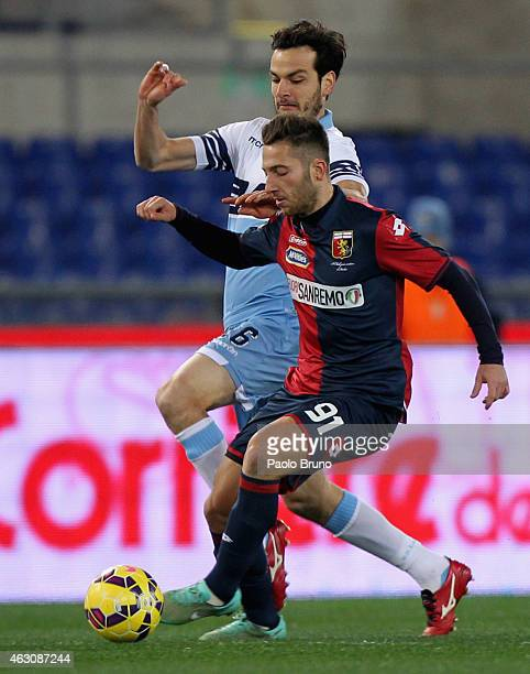 Andrea Bertolacci of Genoa CFC competes for the ball with Marco Parolo of SS Lazio during the Serie A match between SS Lazio and Genoa CFC at Stadio...