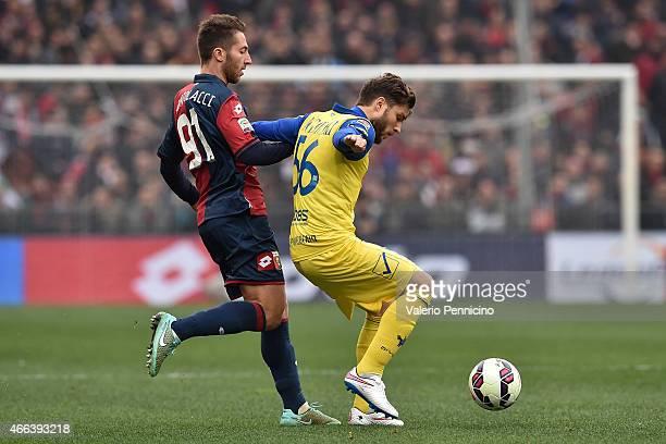 Andrea Bertolacci of Genoa CFC competes with Perparim Hetemaj of AC Chievo Verona during the Serie A match between Genoa CFC and AC Chievo Verona at...