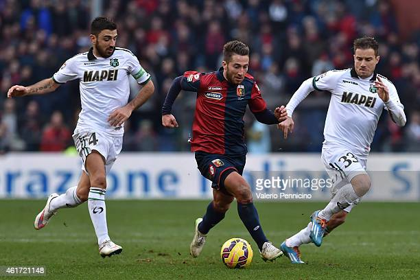 Andrea Bertolacci of Genoa CFC in action against Francesco Magnanelli and Matteo Brighi of US Sassuolo Calcio during the Serie A match between Genoa...