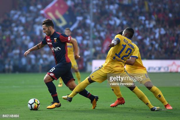 Andrea Bertolacci of Genoa CFC is challenged by Alex Sandro of Juventus during the Serie A match between Genoa CFC and Juventus at Stadio Luigi...