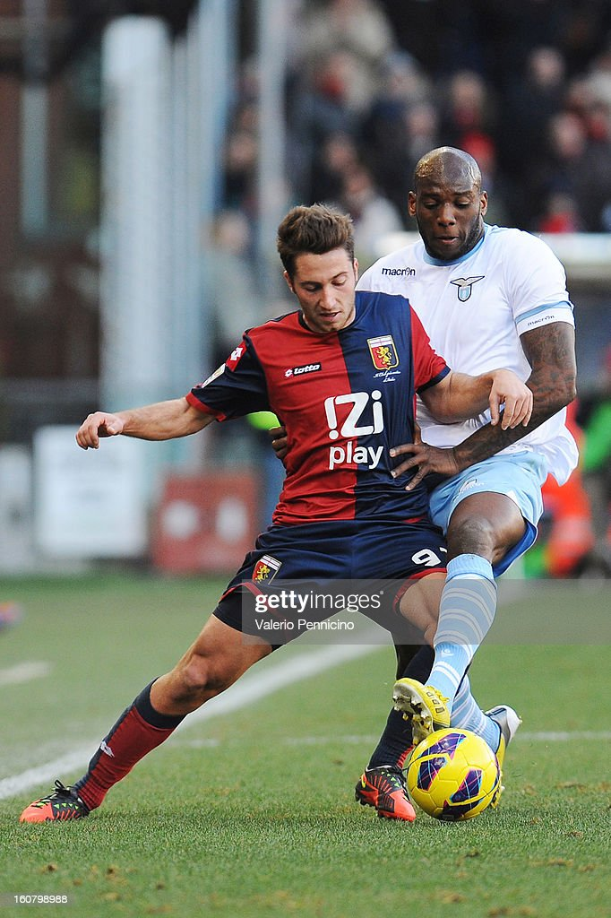 Andrea Bertolacci (L) of Genoa CFC is challenged by Michael Ciani of S.S. Lazio during the Serie A match between Genoa CFC and SS Lazio at Stadio Luigi Ferraris on February 3, 2013 in Genoa, Italy.