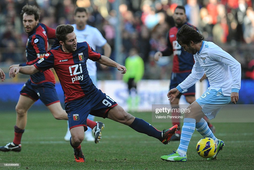 Andrea Bertolacci (L) of Genoa CFC is tackled by Alvaro Gonzalez of S.S. Lazio during the Serie A match between Genoa CFC and SS Lazio at Stadio Luigi Ferraris on February 3, 2013 in Genoa, Italy.