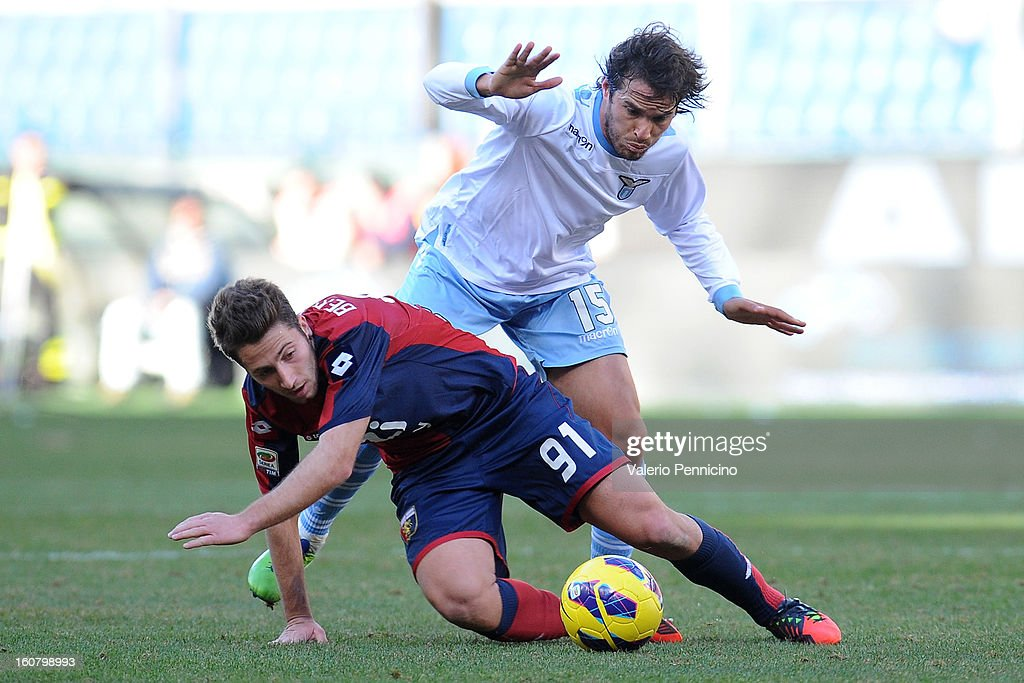 Andrea Bertolacci (L) of Genoa CFC is tackled by <a gi-track='captionPersonalityLinkClicked' href=/galleries/search?phrase=Alvaro+Gonzalez+-+Soccer+Player&family=editorial&specificpeople=2261829 ng-click='$event.stopPropagation()'>Alvaro Gonzalez</a> of S.S. Lazio during the Serie A match between Genoa CFC and SS Lazio at Stadio Luigi Ferraris on February 3, 2013 in Genoa, Italy.
