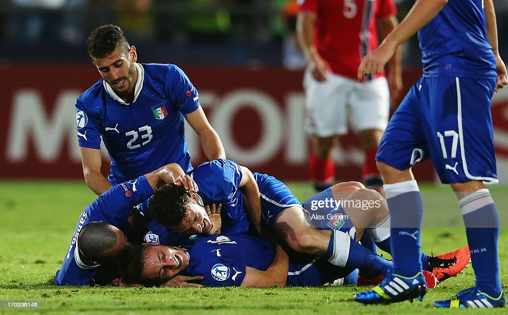 Andrea Bertolacci of Italy celebrates his team's first goal with team mates during the UEFA European U21 Championship Group A match between Norway and Italy at Bloomfield Stadium on June 11, 2013 in Tel Aviv, Israel.
