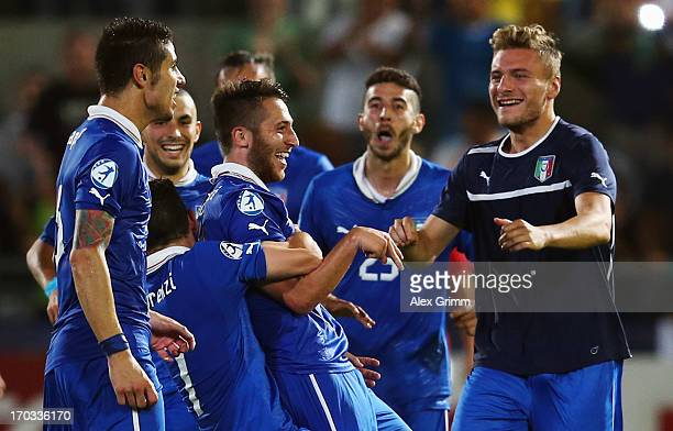 Andrea Bertolacci of Italy celebrates his team's first goal with team mates during the UEFA European U21 Championship Group A match between Norway...
