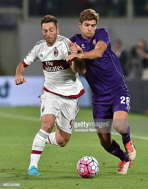 Andrea Bertolacci of Milan and Marcos Alonso of Fiorentina in action during the Serie A match between ACF Fiorentina and AC Milan at Stadio Artemio...