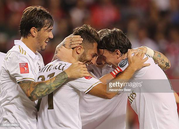 Andrea Bertollaci of Milan celebrates his goal together with teammates Riccardo Montolivo and Alessio Romagnoli during the International Champions...