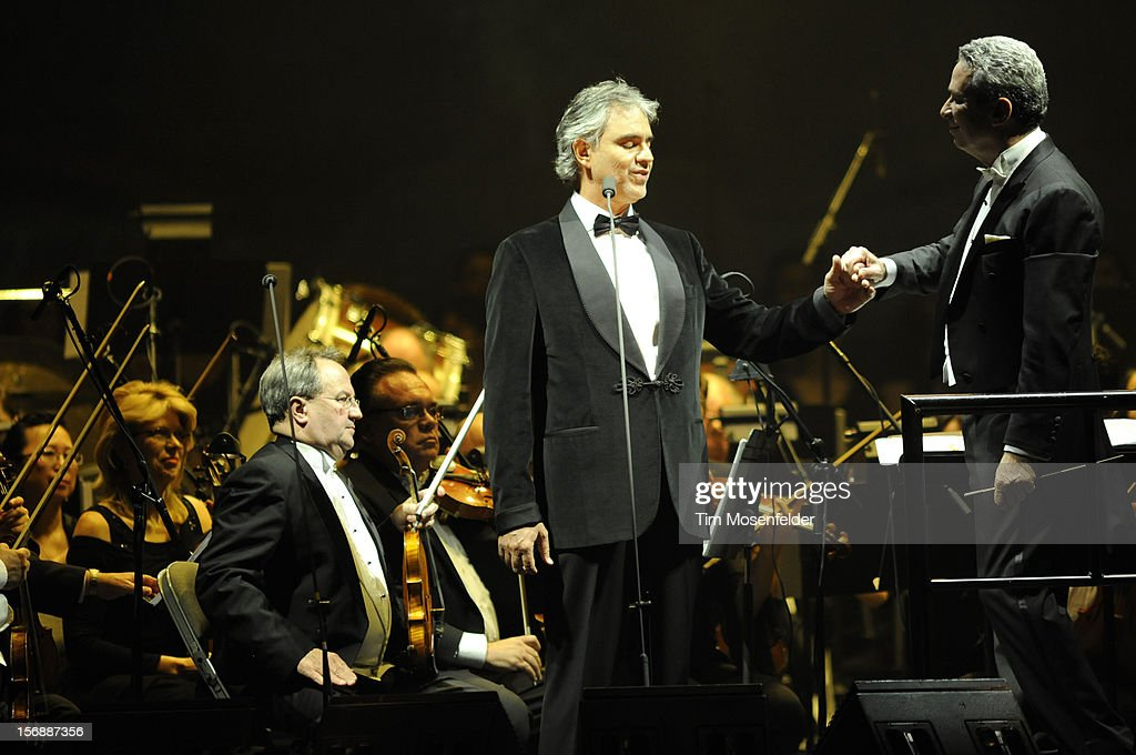 Andrea Bocelli (C) and Conductor Eugene Kohn perform in support of Andrea's Opera release at HP Pavilion on November 23, 2012 in San Jose, California.