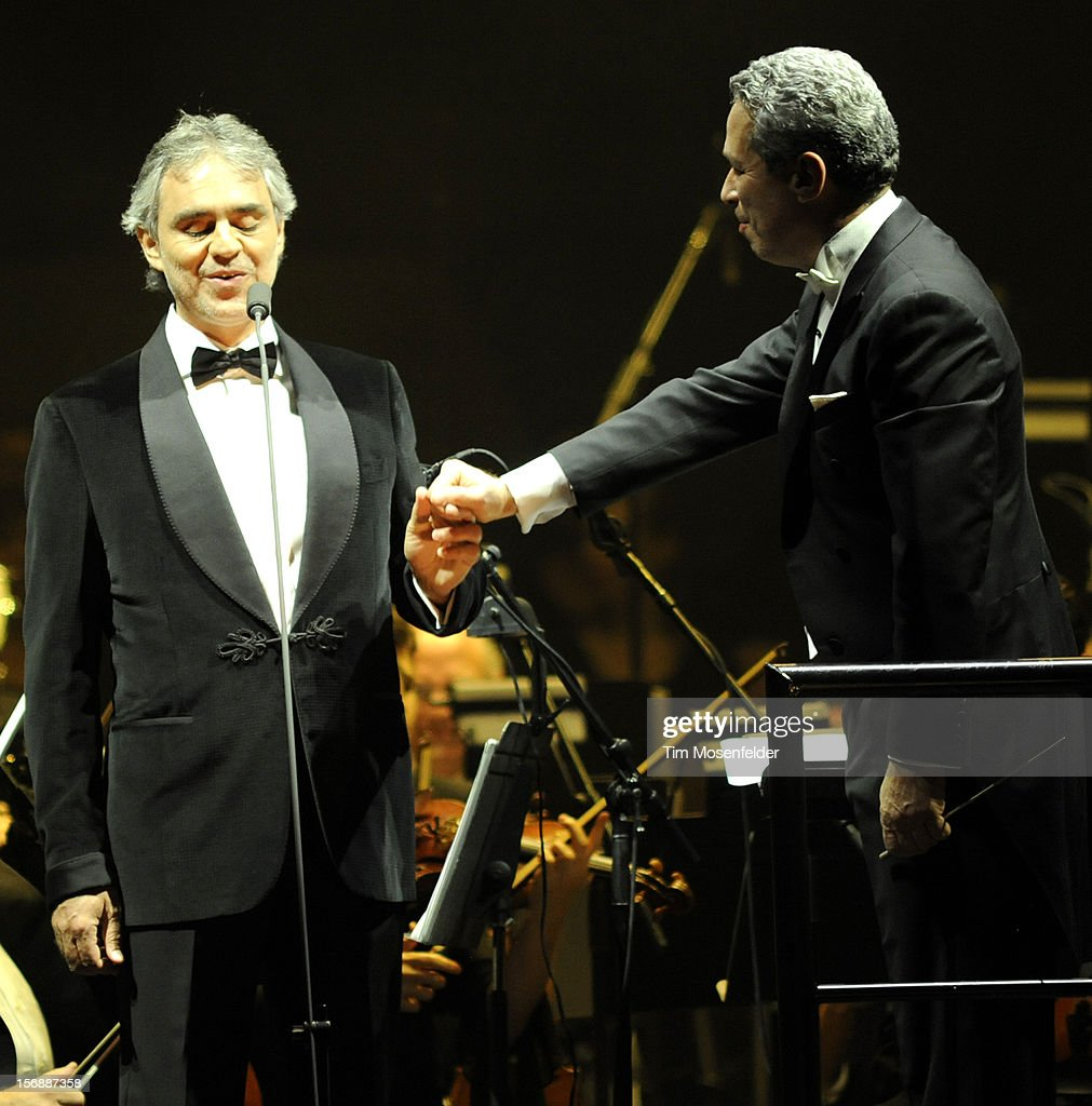 Andrea Bocelli (L) and Conductor Eugene Kohn perform in support of Andrea's Opera release at HP Pavilion on November 23, 2012 in San Jose, California.