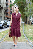 Andrea Bogdan poses wearing a vintage dress and Adidas slides on September 17 2014 in Milan Italy