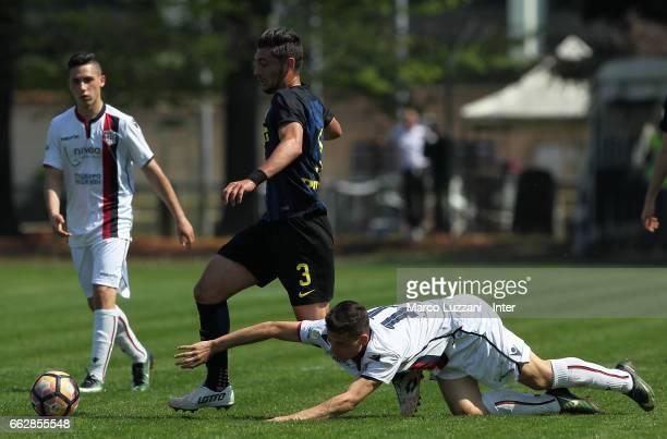 Andrea Cagnano of FC Internazionale is challenged during the Primavera Tim juvenile match between FC Internazionale and Cagliari Calcio at Stadio...