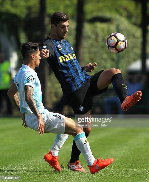 Andrea Cagnano of FC Internazionale Milano is challenged during the Primavera Tim juvenile match between FC Internazionale and Virtus Entella at...