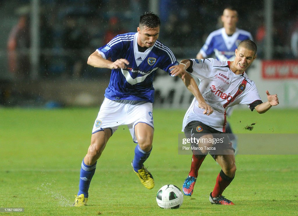 Andrea Caracciolo of Brescia (L) and Fabrizio Paghera of Virtus Lanciano compete for the ball during the Serie B match between Brescia Calcio and Virtus Lanciano at Mario Rigamonti Stadium on August 24, 2013 in Brescia, Italy.