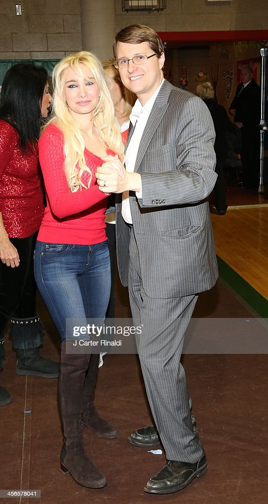 <a gi-track='captionPersonalityLinkClicked' href=/galleries/search?phrase=Andrea+Catsimatidis&family=editorial&specificpeople=6726745 ng-click='$event.stopPropagation()'>Andrea Catsimatidis</a> and <a gi-track='captionPersonalityLinkClicked' href=/galleries/search?phrase=Christopher+Nixon+Cox&family=editorial&specificpeople=6726746 ng-click='$event.stopPropagation()'>Christopher Nixon Cox</a> attends CitySightseeing New York 2013 holiday toy drive at PAL's Harlem Center on December 14, 2013 in New York City.