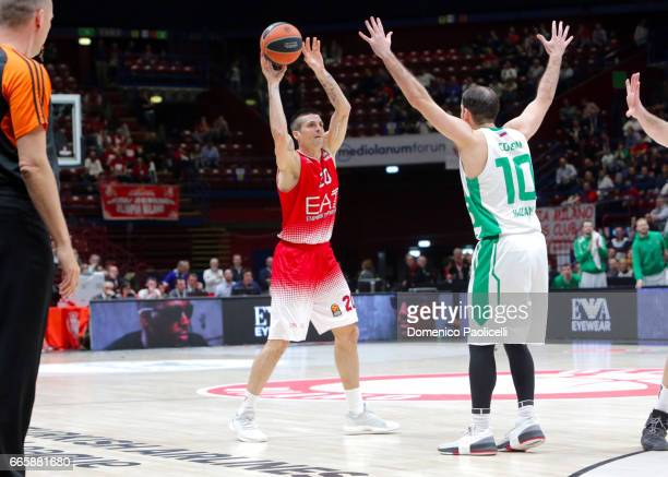 Andrea Cinciarini #20 of EA7 Emporio Armani Milan competes with Quino Colom #10 of Unics Kazan during the 2016/2017 Turkish Airlines EuroLeague...