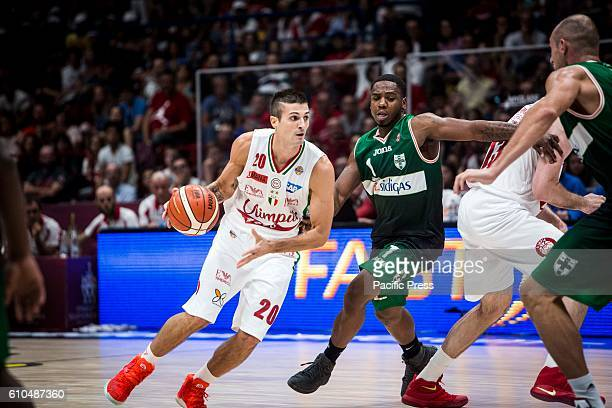 Andrea Cinciarini drives to the basket during the final of Macron Supercoppa 2016 basketball match between Sidigas Avellino vs EA7 Emporio Armani...